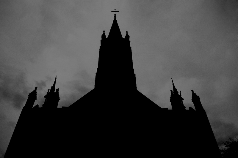 local church on a dark, gloomy day.